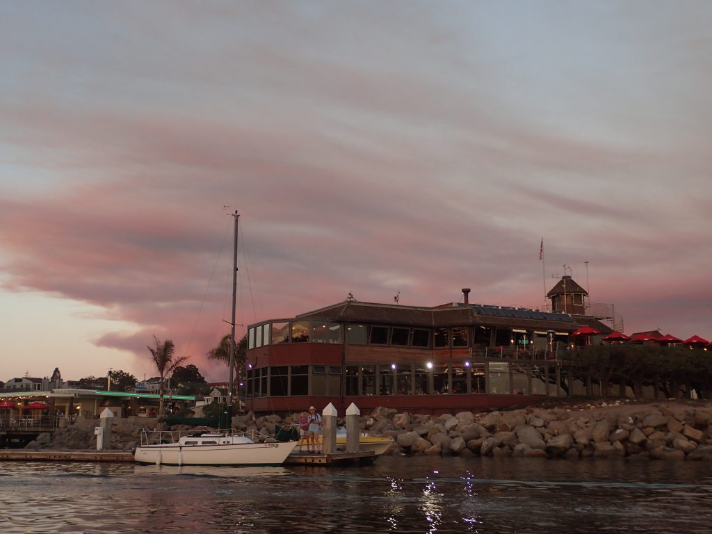 The Crow's Nest restaurant at the Santa Cruz Yacht Harbor, with the Loma Fire burning in the background. 26 September 2016 © Allison J. Gong